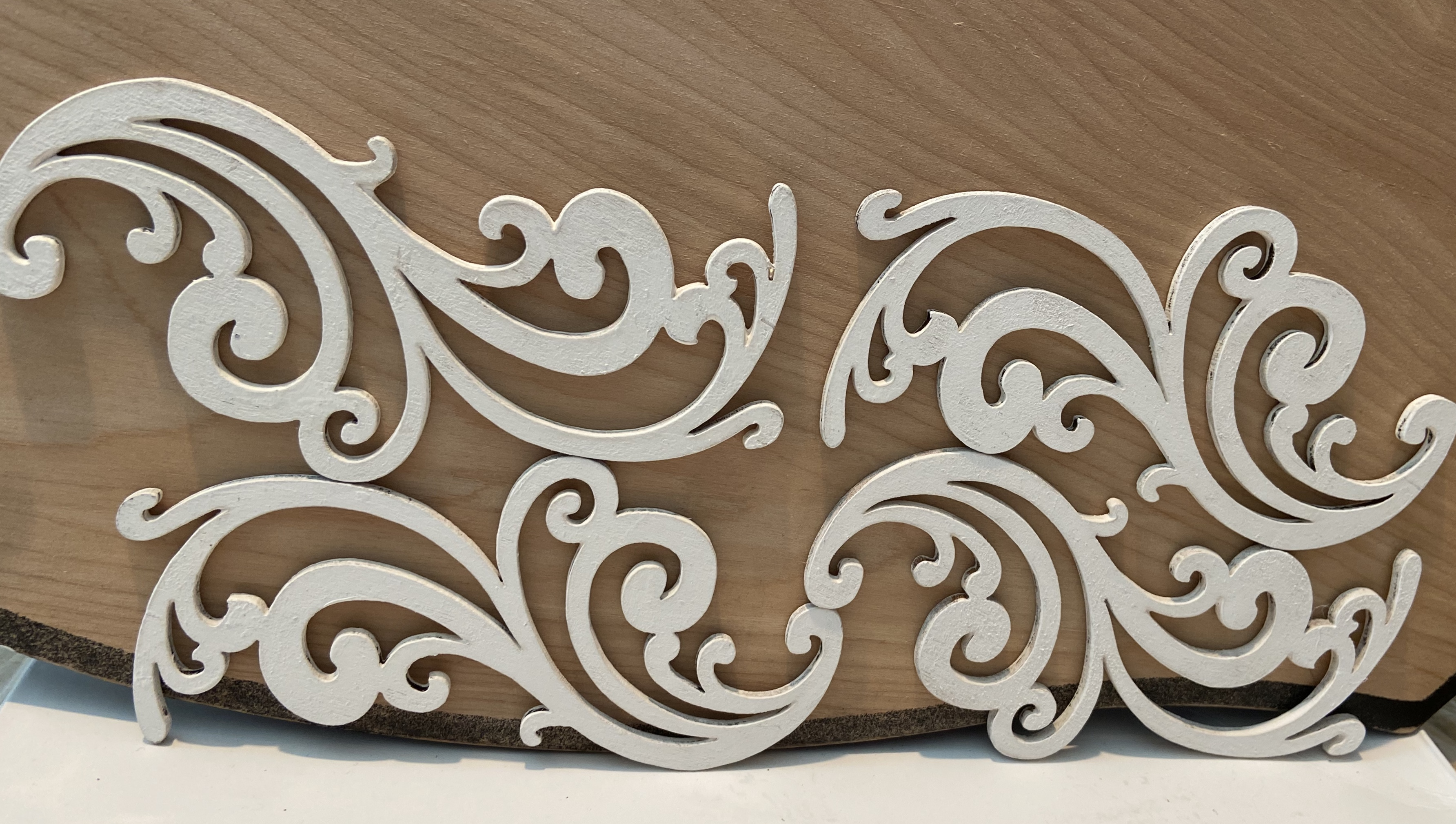 Wooden Scrolls painted white used in vintage lamp makeover.