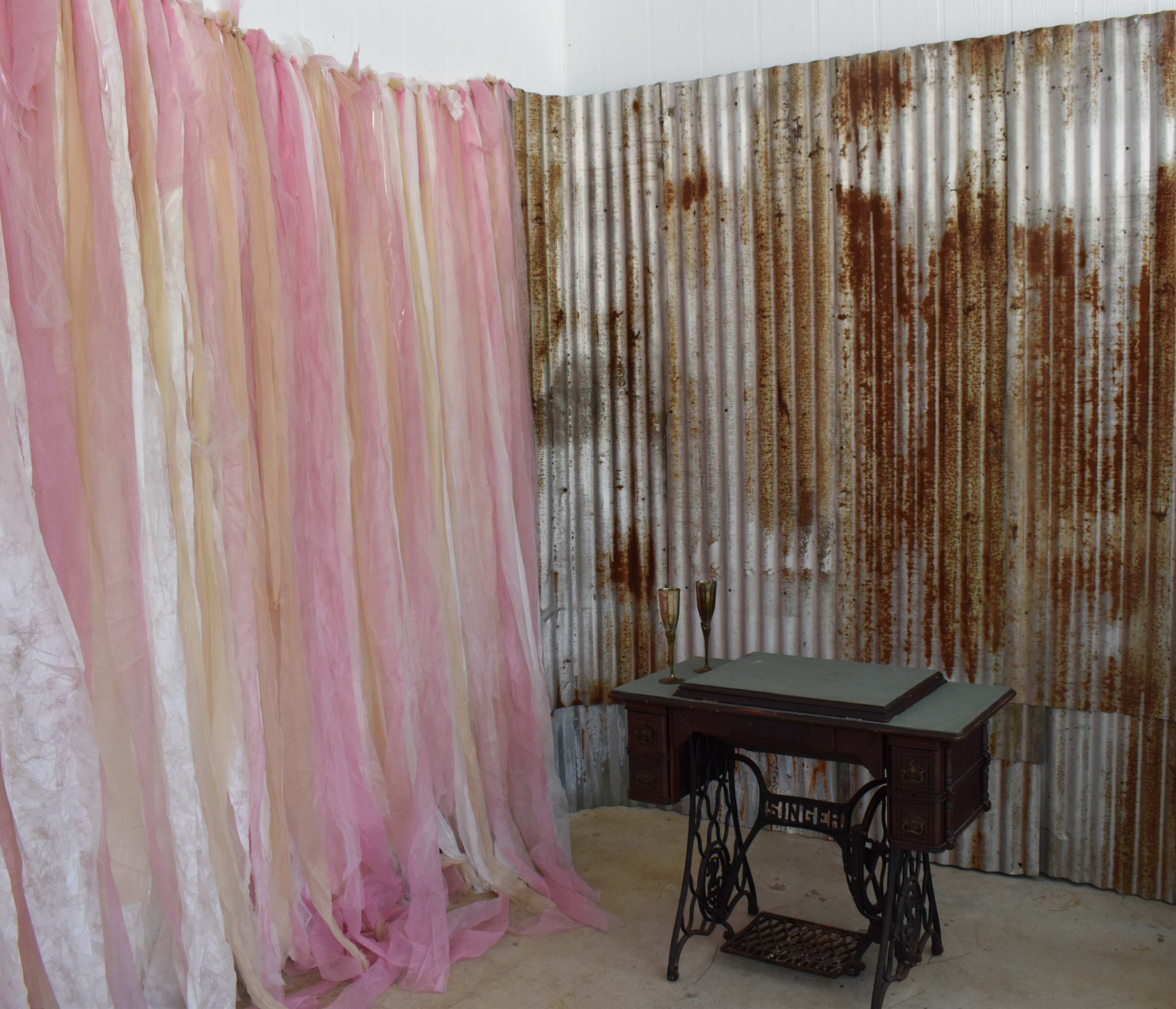 Make a beautiful ribbon curtain for your wedding backdrop and add that extra touch to your vintage look.