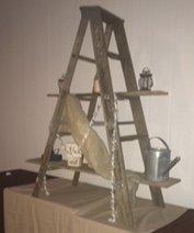 Drape an old ladder with gossamer!